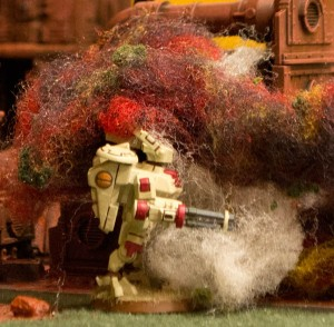 The Tau commander enveloped by Imperial fire. The commander's Crisis Suit eventually was shattered by a hit from the Lemon Russ' battle cannon.