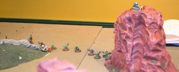 The Gretchin have sat out the battle, but suddenly realize a high-prize objective sits atop the mesa at right.