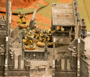 Imperial Guard advance into central ruined building.