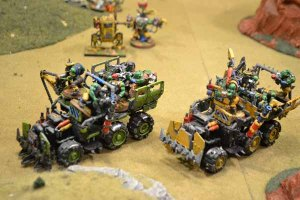 Ork Trukks move flat out toward the Imperial line.