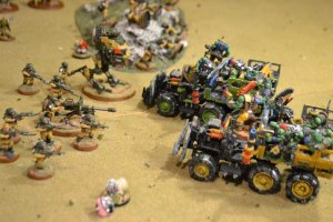 The Trukks charge the Imperial line. The Green Trukk rams the Sentinel; the Yellow Trukk comes up short.