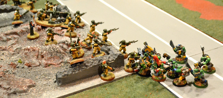 Orks reach the Imperial lines on the first day of battle in the Iron Spires.