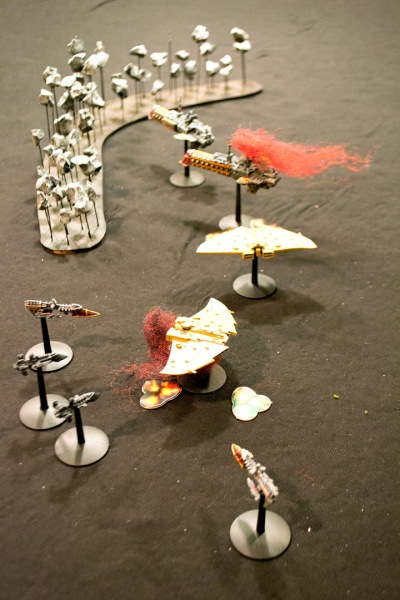 The Divine Retribution is burning, to be destroyed only minutes after Commodore Hennard escapes. Meanwhile, the crippled The Greater Good is rapidly surrounded by Imperial destroyers and frigates.