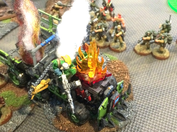 Three flamers and a plasma gun engulf this ork Trukk, incinerating the driver and gunner in holy promethium.